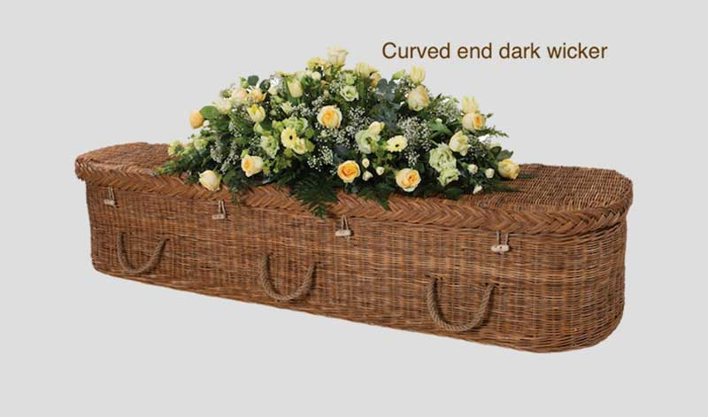 Dark wicker curved end coffin
