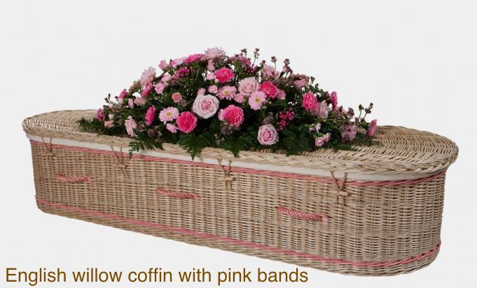 English willow coffin with pink bands and handles